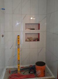 EXPERIENCED AND RELIABLE TILE SETTER INSTALLING TILE Vancouver