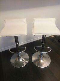 two white leather bar stools Toronto, M5E 1W7