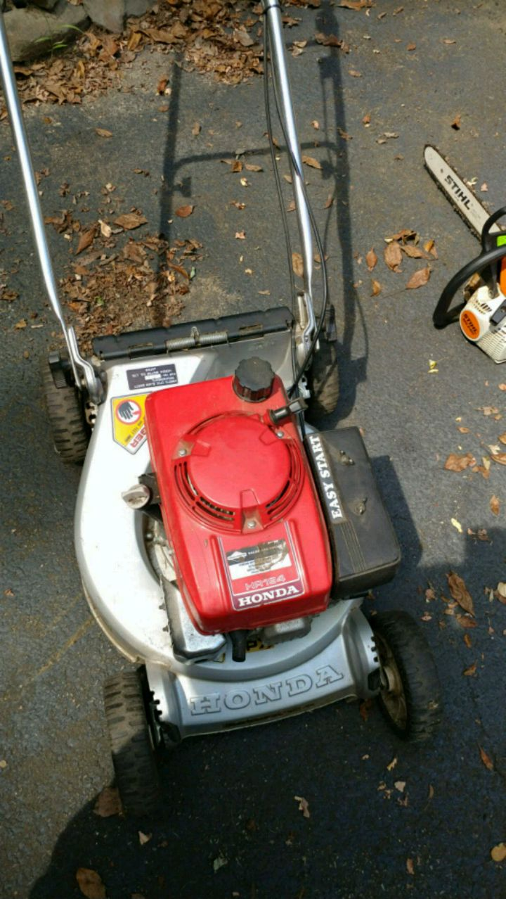 Red And Black Honda Push Mower