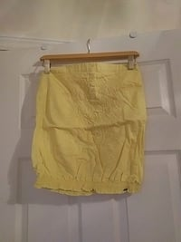 Yellow strapless top from garage. Size small.