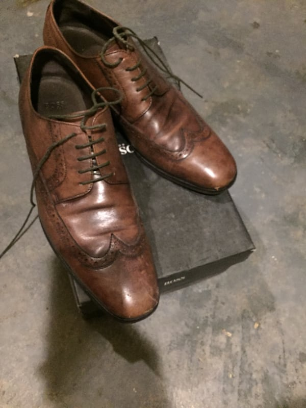 pair of brown Hugo Boss wingtip shoes with box f263c2a1-af0c-4b24-b16a-afc8ea80577b