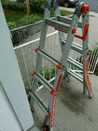 gray and red Werner A-frame ladder Laval, H7A 1Z1