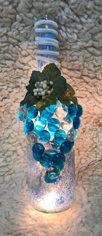 Wine bottle decorated with grapes. Lights up Champion, 44483
