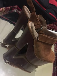 Pair of brown suede boots Vancouver, V6A 3K1