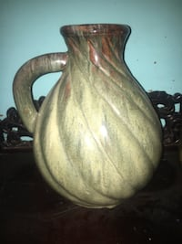 brown and white ceramic vase