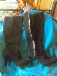 pair of black leather heeled boots Colorado Springs, 80906