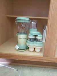 green and beige Baby Bullet food processor