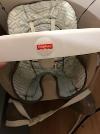 Baby's white and gray graco highchair comes with extra cover to 292 mi