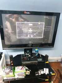 42 in flat screen TV stand Xbox 360 and games