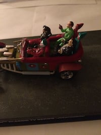 The joker and company action figure riding car figurine