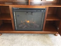 brown and black electric fireplace 2254 mi