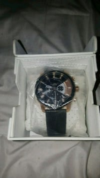 round black chronograph watch with black leather s Calgary, T2N 1L3