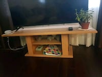brown wooden TV stand with flat screen television Richmond Hill, L4C 2H6