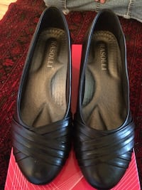 pair of black almond toe rasolli heeled shoes with box