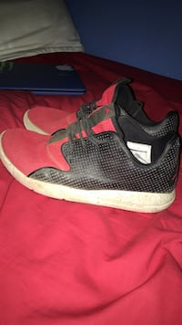 Black-and-red Air Jordan basketball shoes Thunder Bay, P7B 6L3