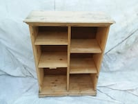 Wooden storage case about 4 feet tall