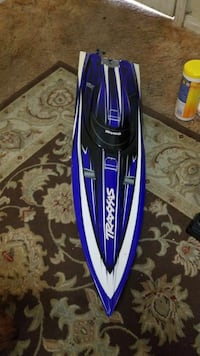 white and blue hydroplane toy