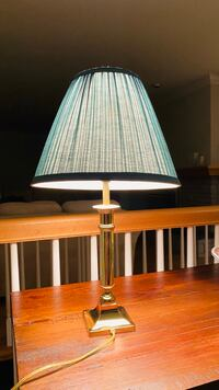 A nice green bed lamp with bulb
