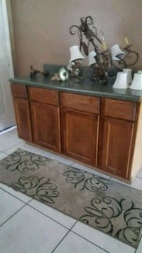 Brown wooden cabinet with green counter top Orlando, 32824