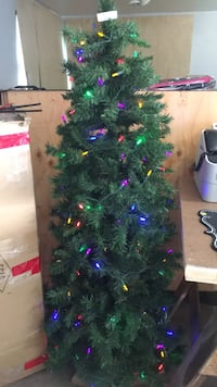 Lit Christmas tree with stand. 5ft must pick up!