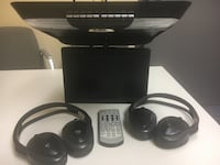 Two black wireless headphones with dvd player and remote Toronto