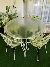 round white metal framed glass top table with chai Saint Cloud, 34769
