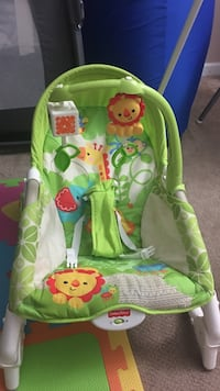 baby's white and green Fisher-Price sleeper