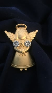 JJ stamped, gold toned little girl angel holding movable silver toned flowers pendant. Wichita, 67211