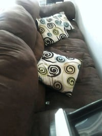 Brown couch and love seat with pillows  Topeka