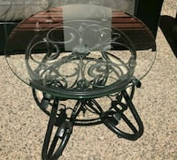 round glass-top coffee table with black metal base Las Cruces, 88001