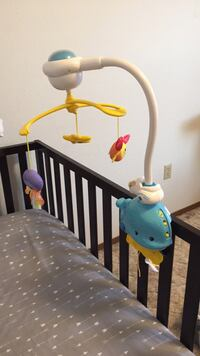 baby's white and blue crib mobile