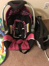 Baby's black and pink car seat carrier