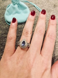 Tanzanite teardrop pear ring in size 6. White gold and white side diamonds. Negotiable  Port Washington North, 11050