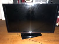black flat screen TV with remote Falls Church, 22041