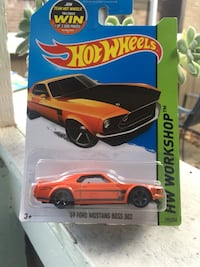 1969 orange Ford Mustang Boss 302 Hot wheels die-cast scale model with pack Houston, 77049