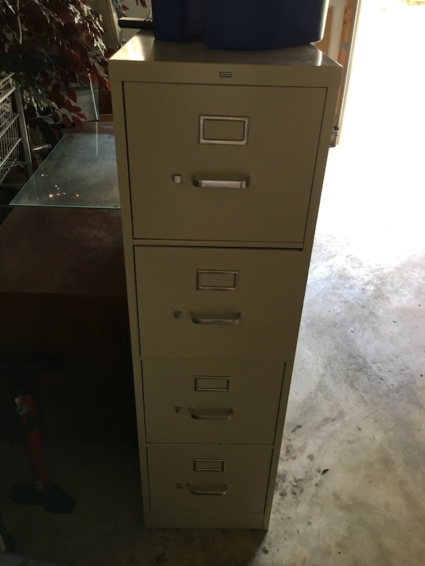 white metal 4-drawer filing cabinet