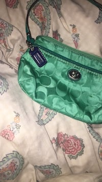 green and black Coach leather wristlet