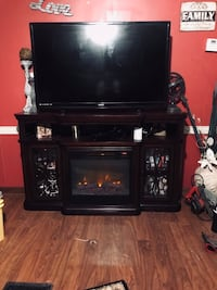 black flat screen TV; brown wooden TV stand Baton Rouge, 70816