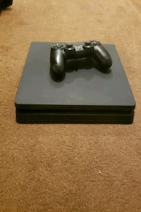 black Sony PS4 console with controller Brandon Township, 48462