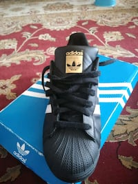 black and blue Adidas Superstar Houston, 77022
