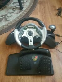 black and gray Snopy steering wheel game controlle Fort Collins, 80521