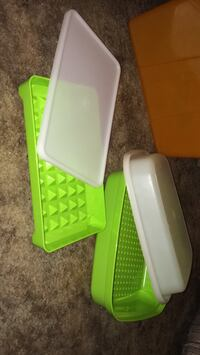 Two rectangular green-and-white plastic containers