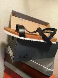 unpaired black and brown sandal on box Dallas, 75243