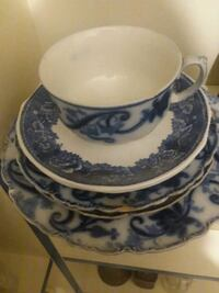 white and blue ceramic teacup and saucer 468 mi