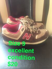 pair of black-and-red New Balance sneakers Troy, 12182