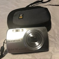silver Olympus point-and-shoot camera