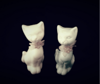 35 year old Porcelain Cats  null