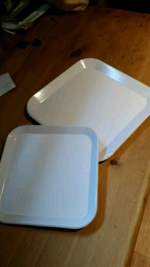 white and blue plastic container
