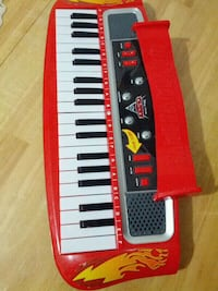 red and black The Cars 2 electronic keyboard Toronto, M6H 3P1