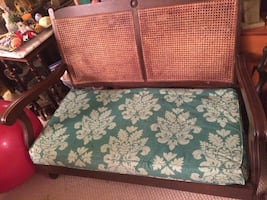 Brown wooden frame and green floral padded chair antique